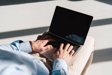 Selective focus of man using laptop with blank screen stock vector