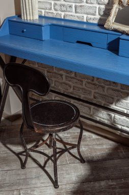 wooden chair at blue table in modern retro styled living room
