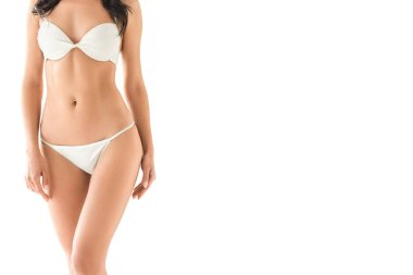 partial view of slim girl posing in white bikini, isolated on white with copy space