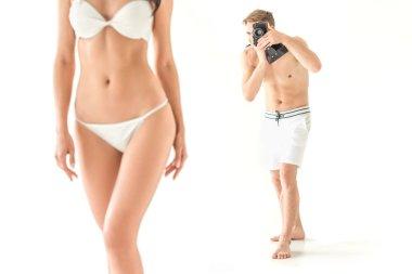 photographer taking photo of beautiful slim woman in swimwear, isolated on white