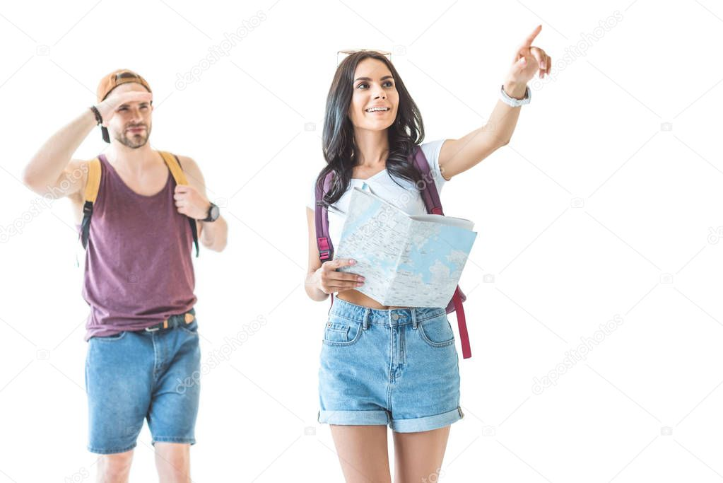 couple of travelers with map pointing somewhere, isolated on white