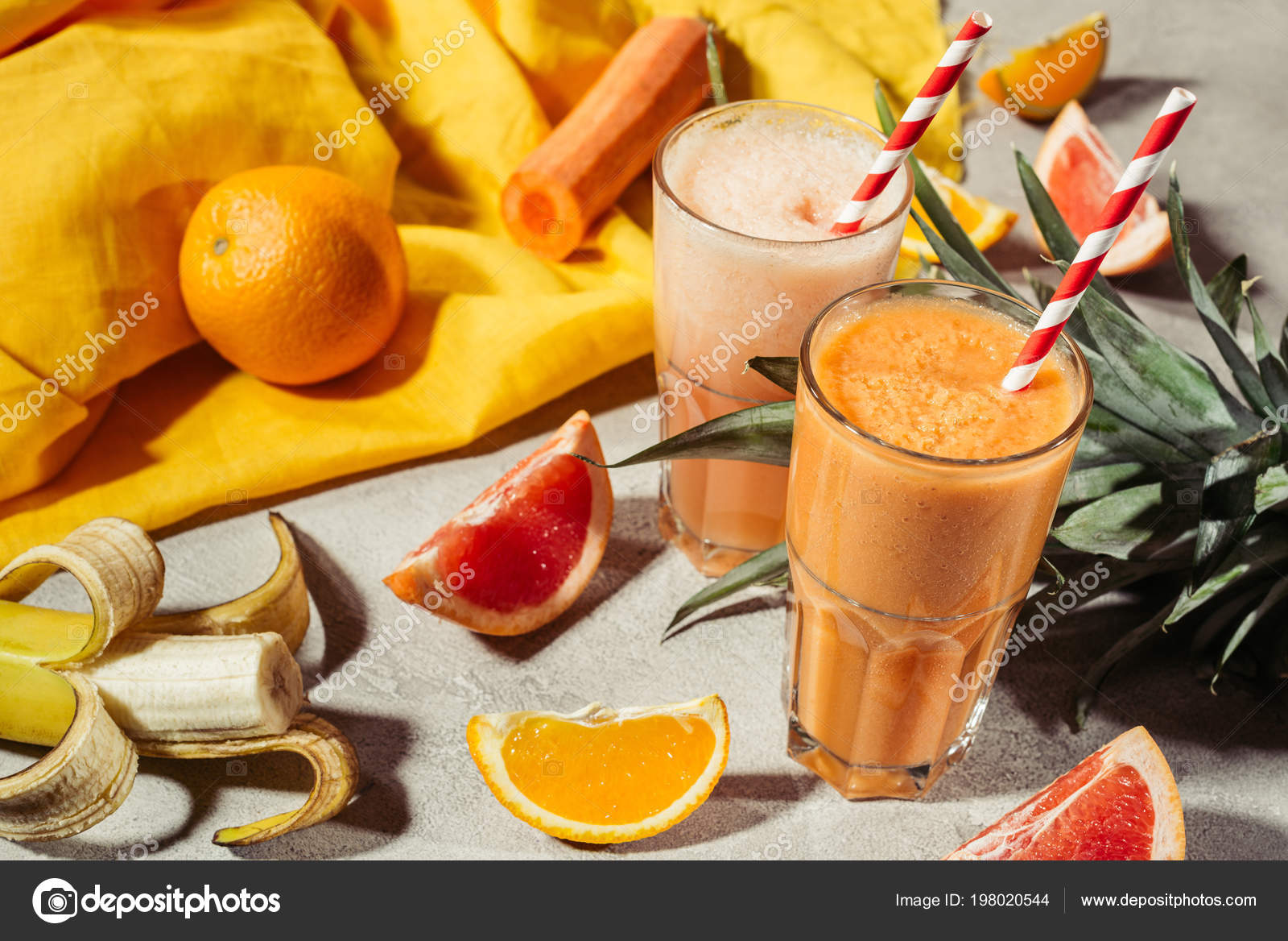 Glasses Tropical Fruits Juice Fruit Pieces Grey Table Stock Photo Image By Edzbarzhyvetsky 198020544