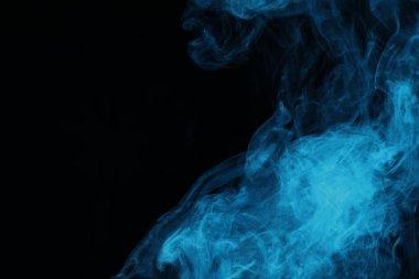 blue mystical smoke on black background
