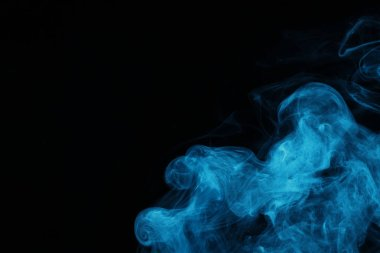 Blue spiritual smoke on black background with copy space stock vector