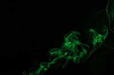 abstract black background with green mystical smoke
