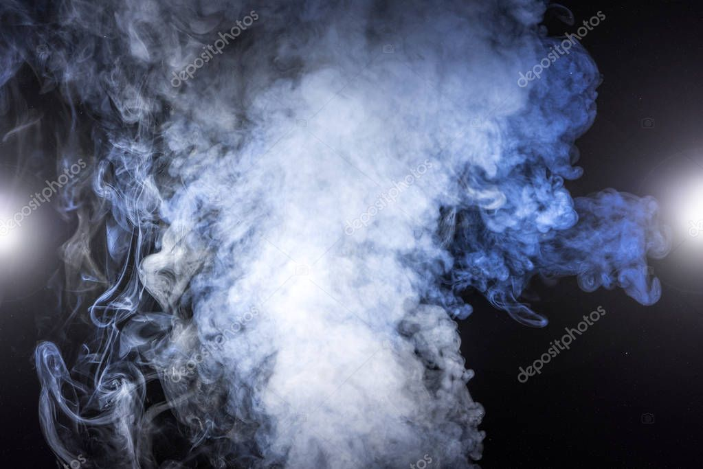 white smoke and glowing lights on black background