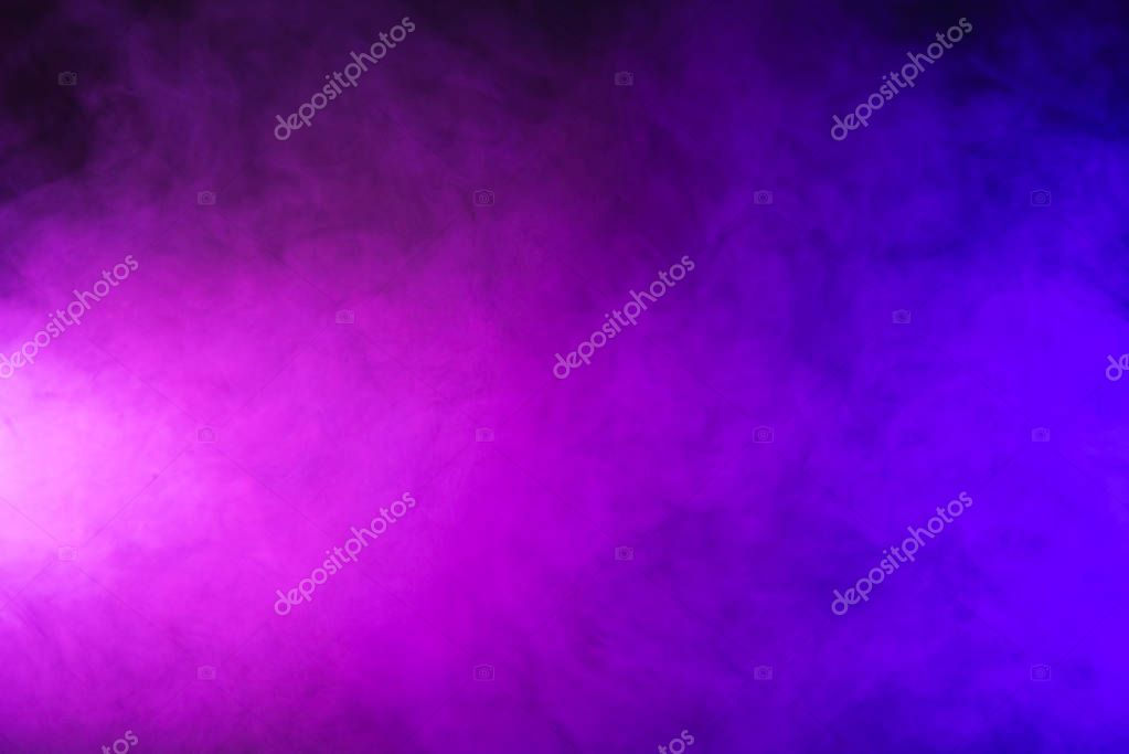 abstract pink and purple smoke on dark background