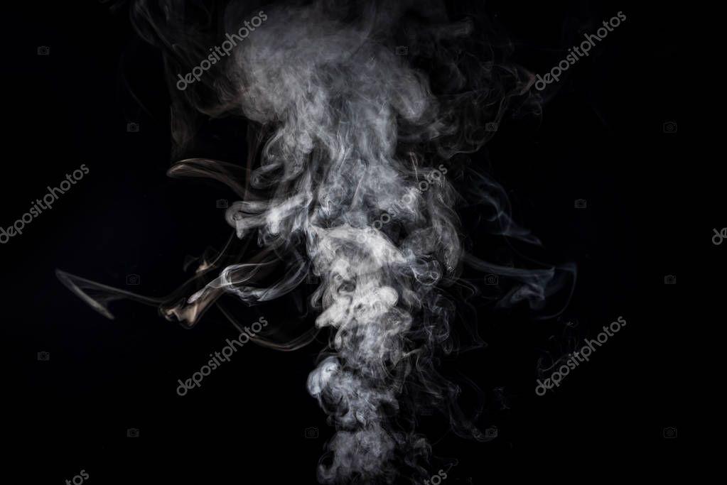 grey smoky swirl from cigarette on black
