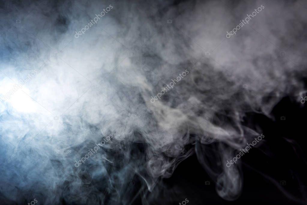 creative background with white smoky swirl on black