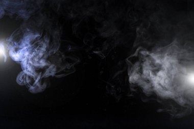grey smoky swirls and lights on black background with copy space