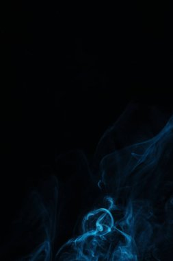 Blue swirl of smoke on black background with copy space stock vector
