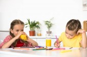 cute little kids drawing pictures at table at home