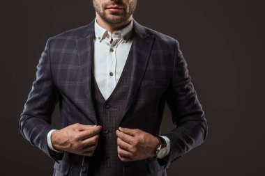 cropped shot of handsome man wearing stylish suit isolated on black
