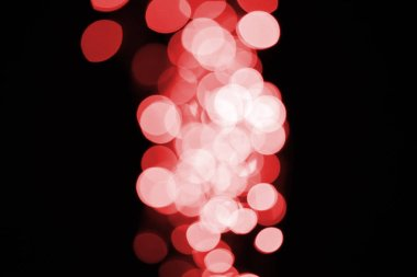 beautiful shiny defocused red bokeh on black background