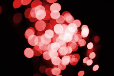 Beautiful shiny defocused red bokeh on black background stock vector