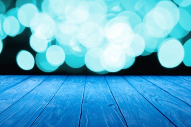 empty wooden surface and beautiful light blue bokeh background