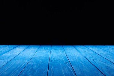 empty light blue wooden planks surface on black background