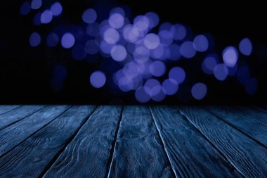 empty wooden surface and beautiful dark blue bokeh background