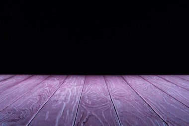 empty purple wooden planks surface on black background