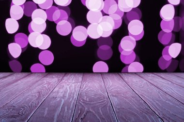 empty wooden surface and beautiful purple bokeh background