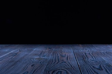 empty blue wooden planks surface on black background