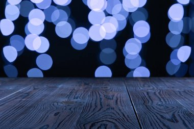 empty wooden surface and beautiful blue bokeh background
