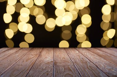 empty wooden surface and beautiful yellow bokeh background