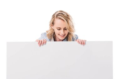 Smiling attractive woman looking at blank placard isolated on white stock vector