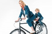 Fotografie mother and son riding bicycle isolated on white