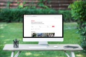 selective focus of computer with airbnb website at table outdoors