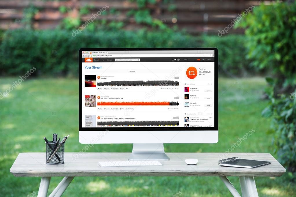 selective focus of computer with soundcloud website at table outdoors