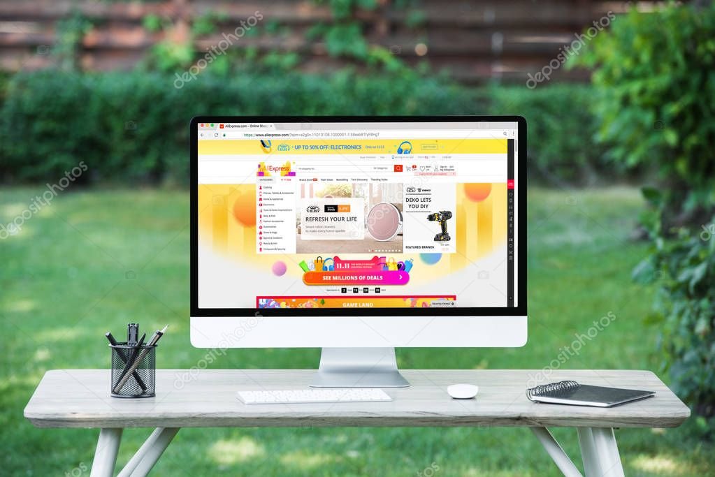 selective focus of computer with aliexpress website at table outdoors