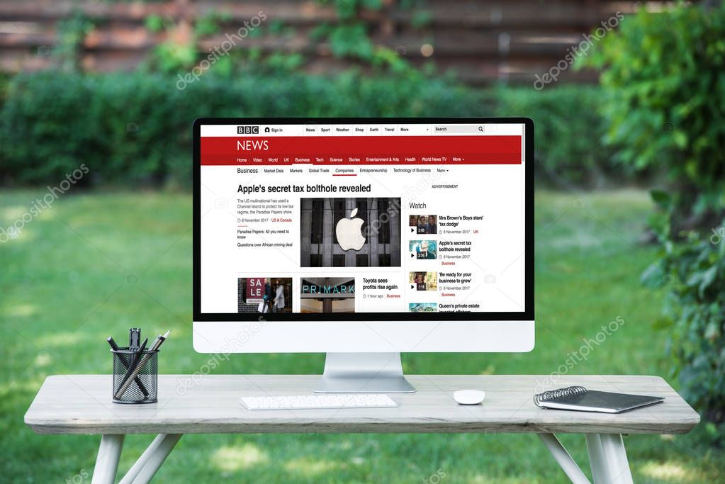 selective focus of computer with bbc news website at table outdoors