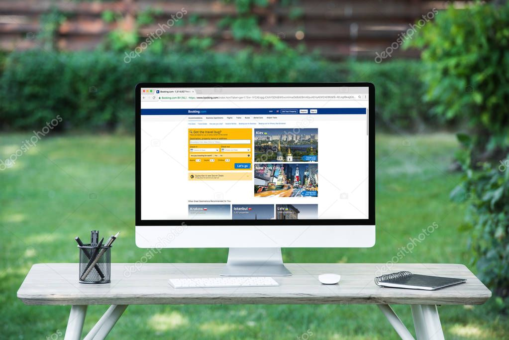 selective focus of computer with booking.com website at table outdoors