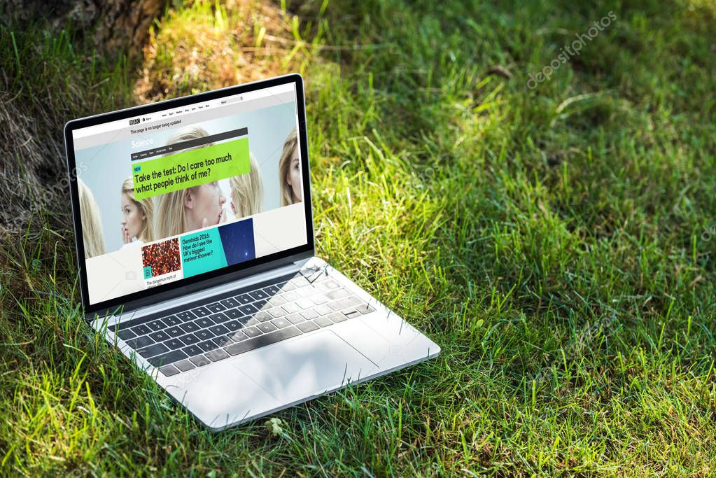 close up view of laptop with bbc science website on grass outdoors