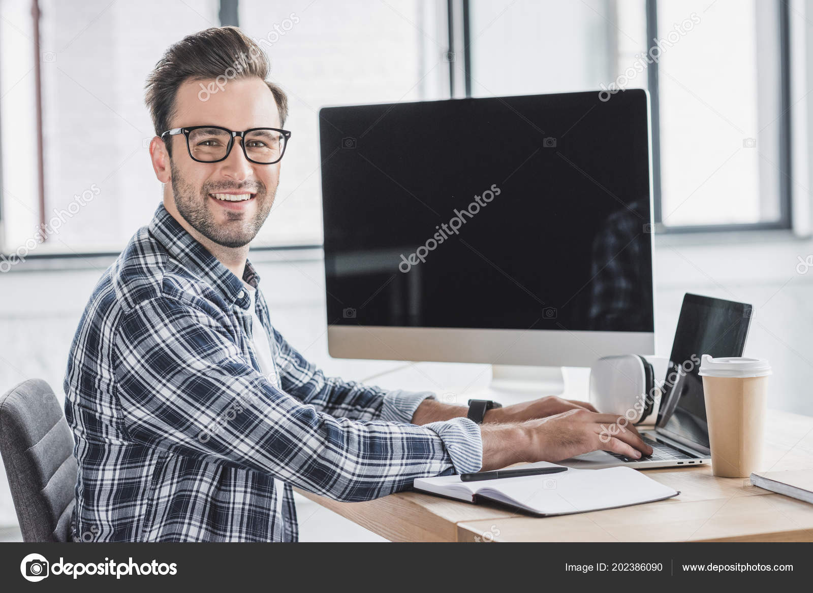 Handsome Young Programmer Eyeglasses Smiling Camera While Working Laptop  Desktop ⬇ Stock Photo, Image by © EdZbarzhyvetsky #202386090