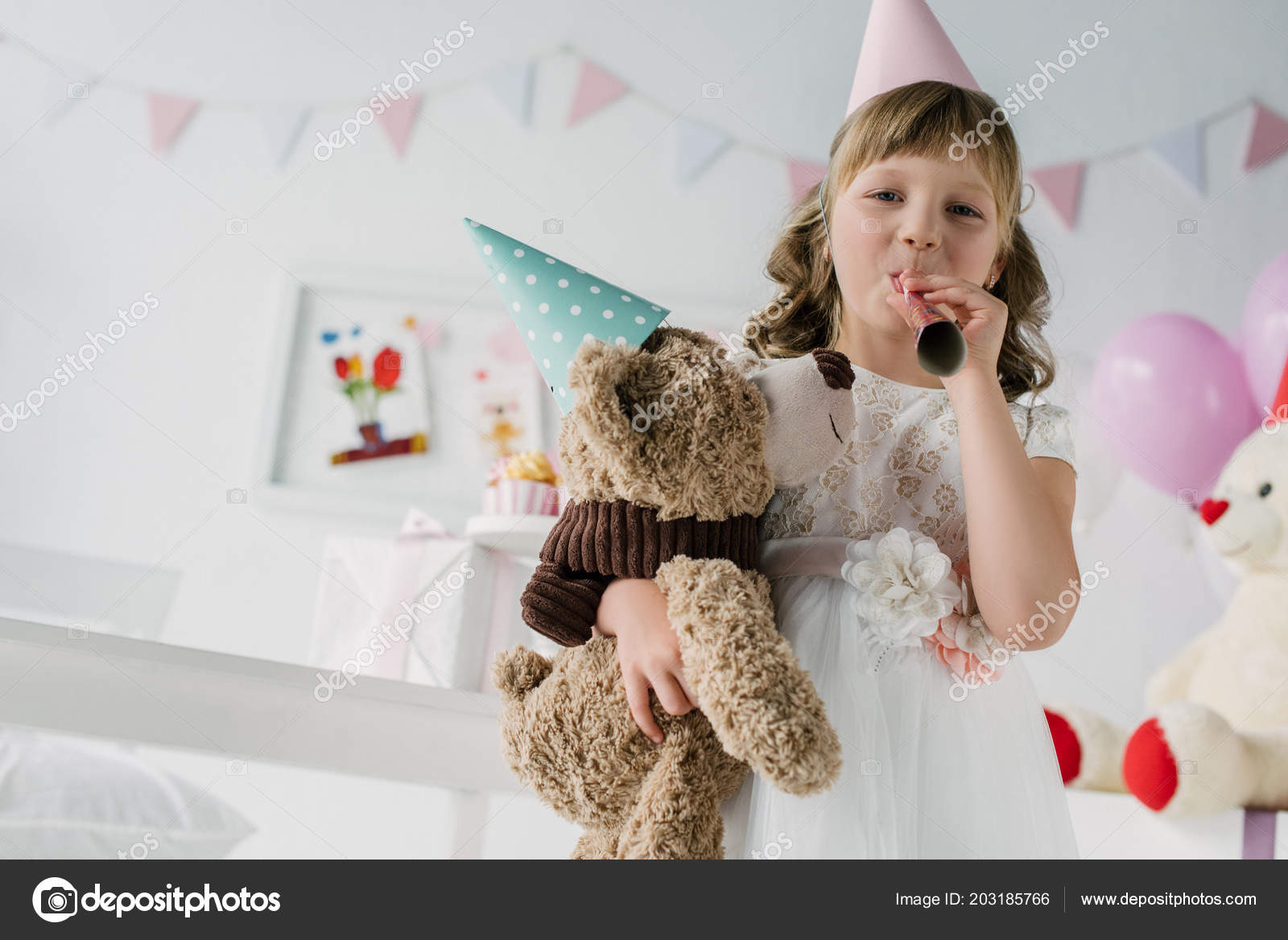 Happy Birthday Child Cone Blowing Party Horn Holding Teddy Bear Stockfoto