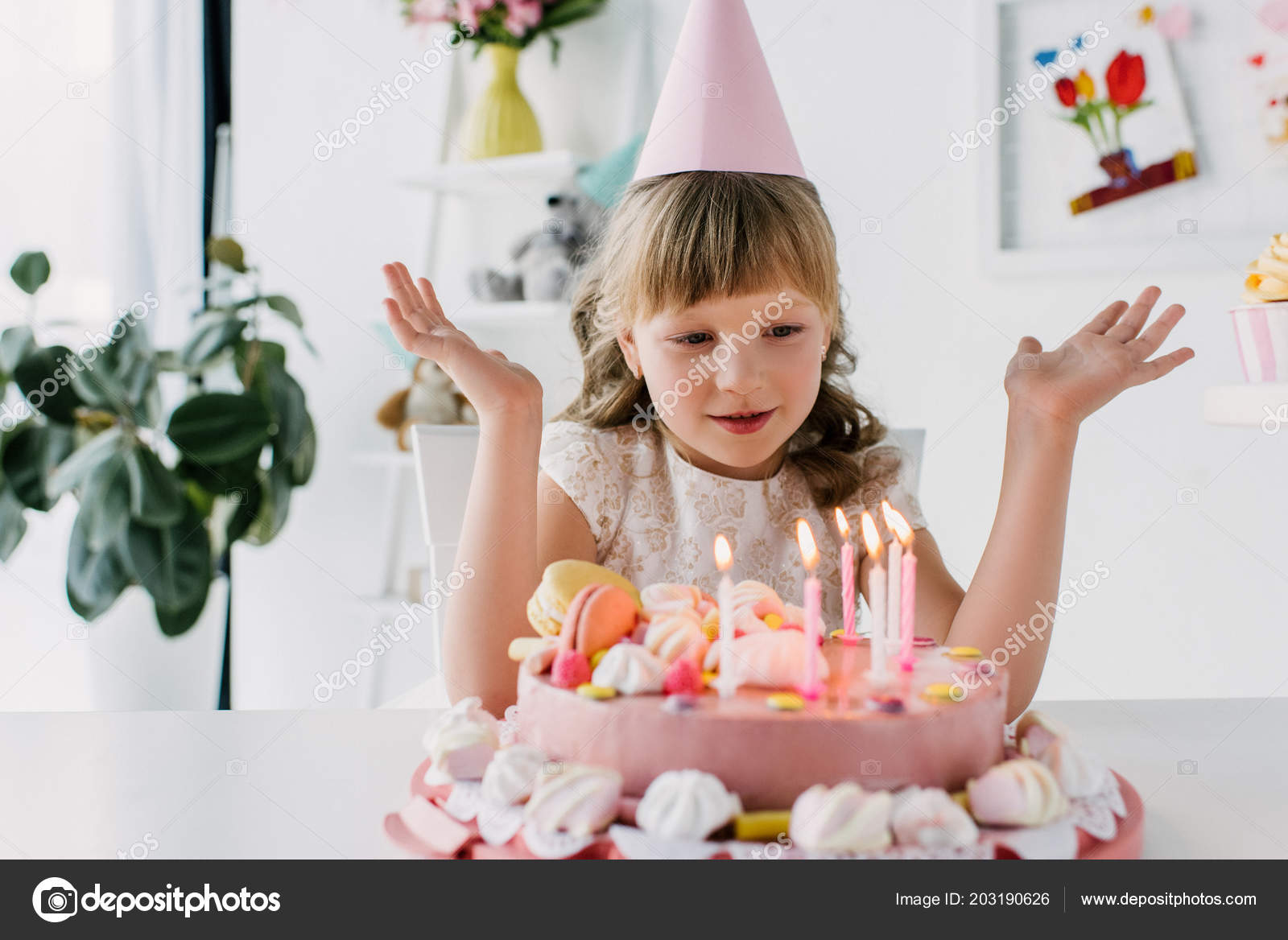 cute kid wide arms looking birthday cake candles — stock photo