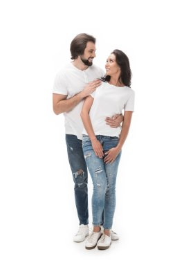 smiling couple looking at each other isolated on white