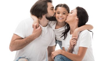 portrait of parents kissing happy daughter isolated on white