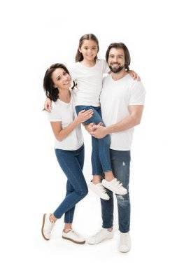 happy family in white shirts and jeans looking at camera isolated on white