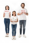 Fotografie smiling family with sale cards and house model isolated on white