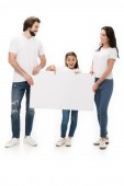 smiling parents and daughter with blank banner isolated on white