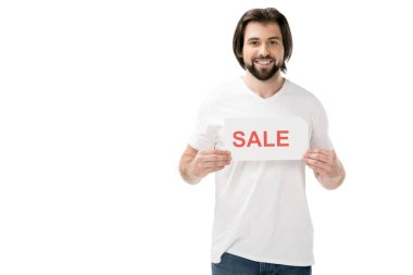 smiling bearded man with sale banner in hands isolated on white