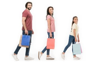 side view of family with shopping bags isolated on white