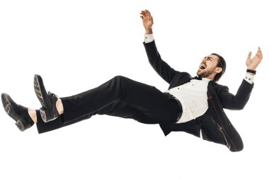 scared young businessman in suit falling isolated on white