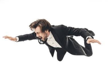 screaming young businessman in suit falling isolated on white
