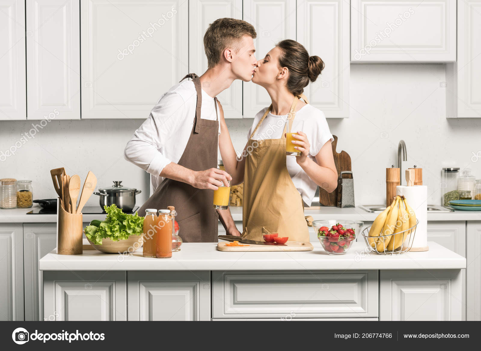 Young Couple Kissing While Cooking Salad Kitchen Stock Photo Image By C Edzbarzhyvetsky 206774766