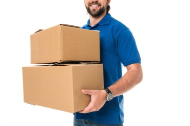 Cropped shot of smiling delivery man holding cardboard boxes isolated on white stock vector