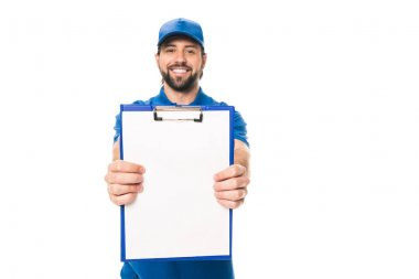 Handsome young delivery man holding blank clipboard and smiling at camera isolated on white stock vector